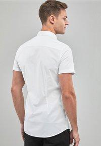 Next - SKINNY FIT SHORT SLEEVE STRETCH OXFORD SHIRT - Shirt - white - 1