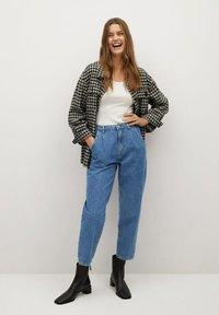 Mango - REGINA - Relaxed fit jeans - middenblauw - 1