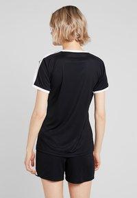 Puma - LIGA - T-shirt med print - black/white - 2