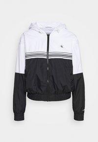 Calvin Klein Jeans - STRIPE TAPE HOODED WINDBREAKER - Summer jacket - black - 4