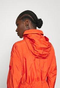 Calvin Klein - PACKABLE JACKET - Summer jacket - fiesta - 4