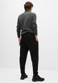 Mango - MARCIANO - Trousers - black - 2