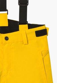 Brunotti - FOOTSTRAP BOYS - Zimní kalhoty - cyber yellow - 6