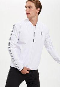 DeFacto Fit - Zip-up hoodie - white - 3