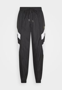 Puma - WORLDHOOD TRACK PANTS - Tracksuit bottoms - black - 0