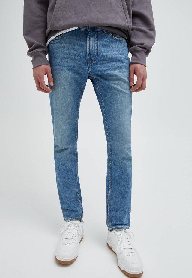 Jean droit - mottled light blue