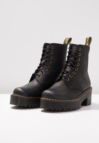 Dr. Martens - SHRIVER HI 8 EYE BOOT - Platform ankle boots - black - 4