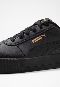 Puma - CARINA  - Baskets basses - black/team gold - 2