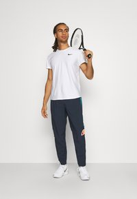 Ellesse - CENNO TRACK PANT - Trousers - navy - 1