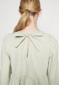 Monki - MARIA PEPLUM BLOUSE - Long sleeved top - green dusty light - 2