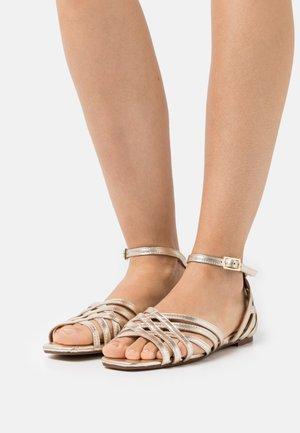 SINDY - Sandals - gold metallic