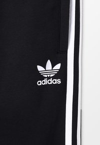 adidas Originals - TREFOIL PANTS - Verryttelyhousut - black/white - 5