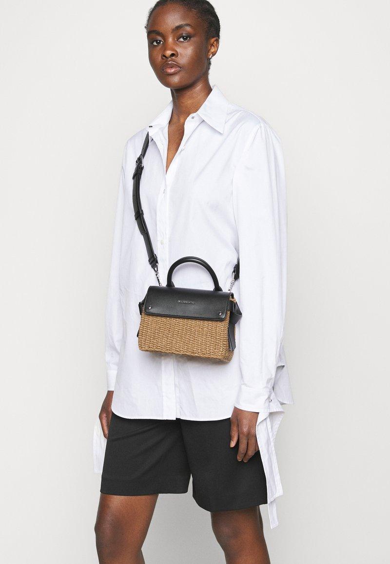 KARL LAGERFELD - IKON MINI TOP HANDLE - Across body bag - natural/black