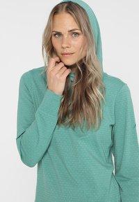 Vaude - WOMENS TUENNO PULLOVER - Long sleeved top - nickel green - 4
