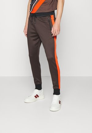 GO TRACK JOGGER - Tracksuit bottoms - chocolate