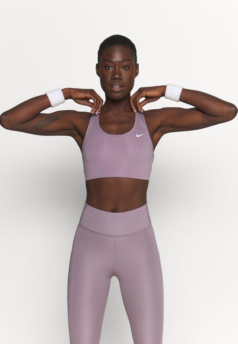 Nike Performance - NON PADDED BRA - Medium support sports bra - purple smoke/white
