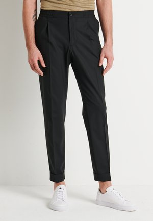 SASHA EVO TRAVEL - Pantaloni - black