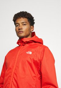 The North Face - MENS QUEST JACKET - Hardshell jacket - orange/mottled black - 3