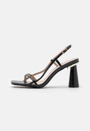 JESSY - Tveida siksniņu sandales - black