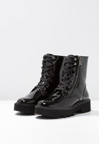 Calvin Klein Jeans - DIAHNE - Platform ankle boots - black - 4