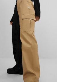 Bershka - Trousers - beige - 3
