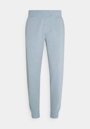 MELVIN PANTS UNISEX - Träningsbyxor - dusty blue