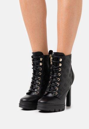 JACLIN - Šněrovací kotníkové boty - black