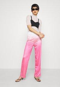 HOSBJERG - RILEY PANTS - Trousers - pink - 1