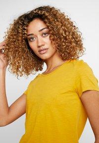 edc by Esprit - OCS BACK DETAIL - Print T-shirt - honey yellow - 3