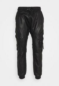 Tigha - TANO - Leather trousers - black - 5