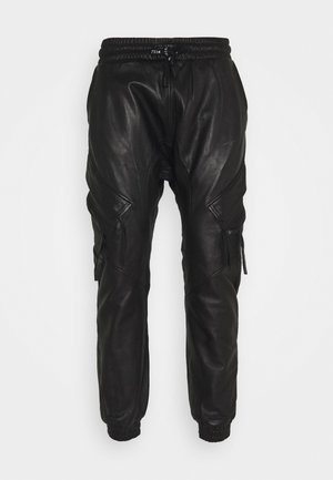 TANO - Leather trousers - black