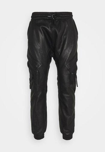 TANO - Kožené kalhoty - black