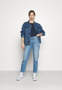 Tommy Jeans - TRUCKER JACKET - Denim jacket - denim light - 1