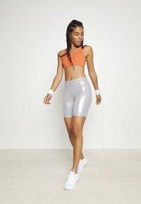 Nike Performance - BRA - Medium support sports bra - light sienna/healing orange - 1