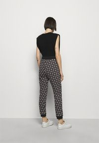 Pinko - ENOLOGIA - Tracksuit bottoms - black - 2