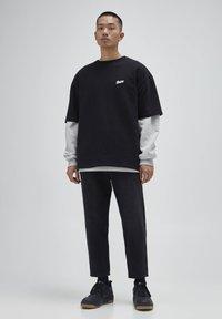 PULL&BEAR - Jeans a sigaretta - mottled dark grey - 1