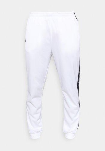 JELGE - Verryttelyhousut - bright white
