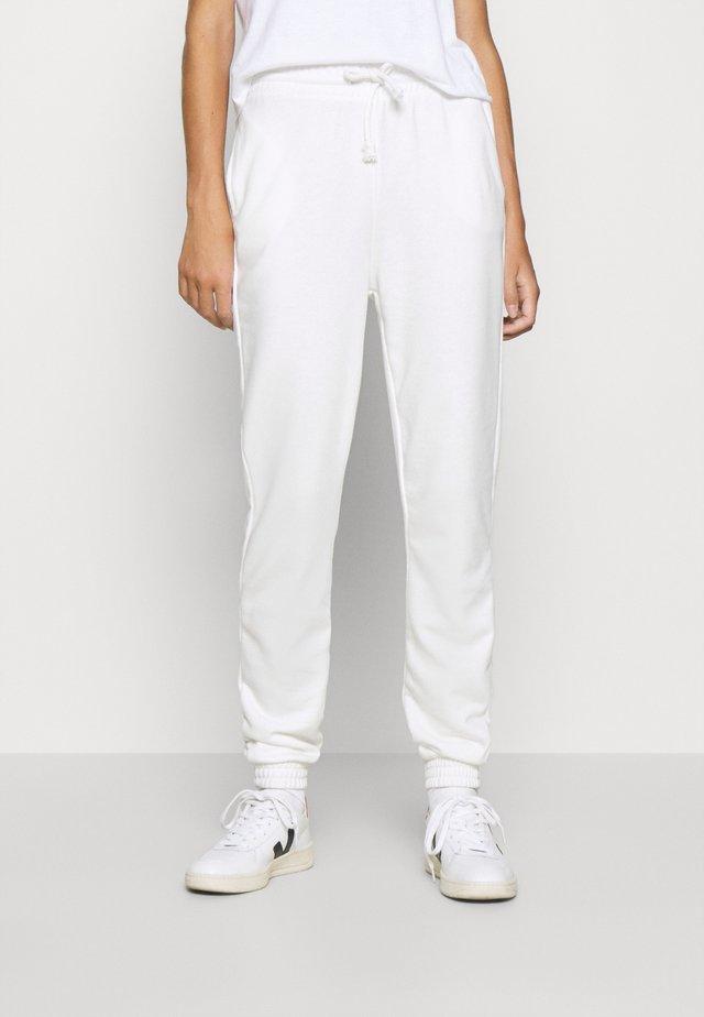 ABIGAIL - Pantalones deportivos - off-white