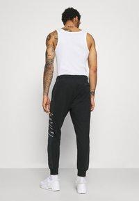 Nike Sportswear - Pantaloni sportivi - black/particle grey/white - 2