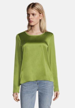 MIT GLANZEFFEKT - Blouse - turtle green