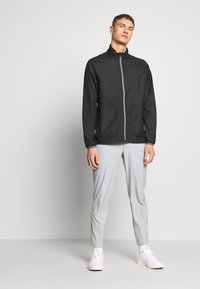 Puma Golf - ZEPHYR JACKET - Větrovka - black - 1
