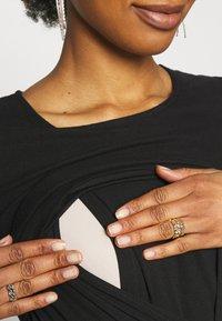 MAMALICIOUS - MLRAINA JUNE MIX KNEE DRESS - Jersey dress - black - 2