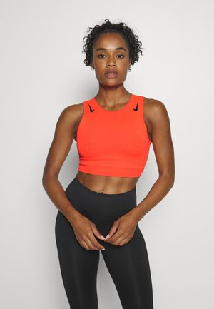 AEROSWIFT CROP - Sports shirt - bright crimson/black