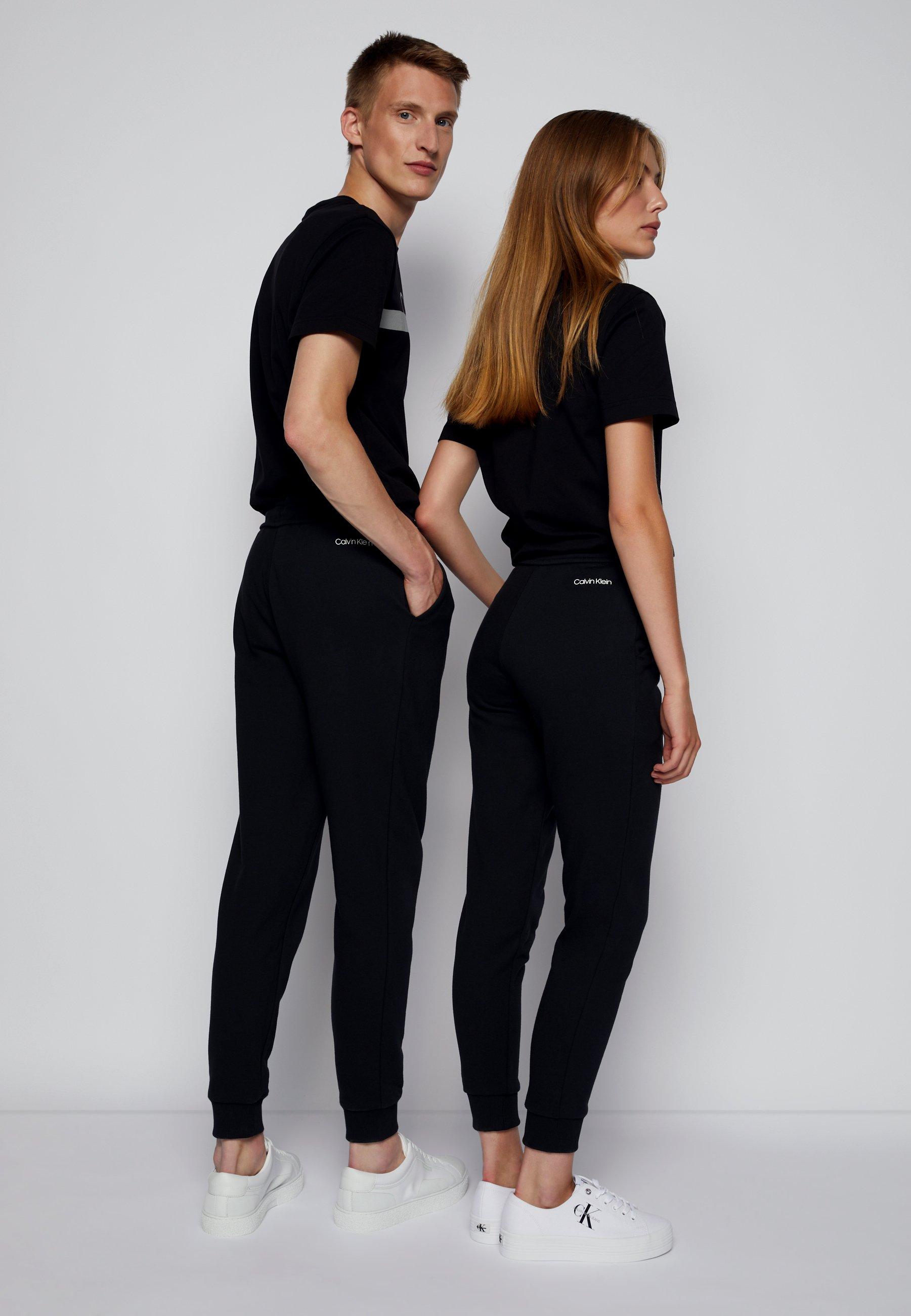 Women REFLECTIVE LOGO UNISEX - Tracksuit bottoms