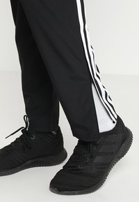 adidas Performance - TIRO 19 - Pantalon de survêtement - black - 5