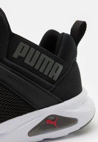 Puma - ENZO 2 WEAVE JR UNISEX - Hardloopschoenen neutraal - black/high risk red - 5
