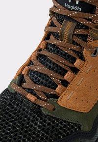Haglöfs - SKUTA MID PROOF ECO - Hiking shoes - olive/brown - 5
