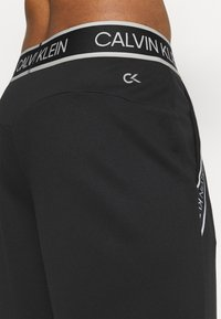 Calvin Klein Performance - PANTS - Tracksuit bottoms - black - 5