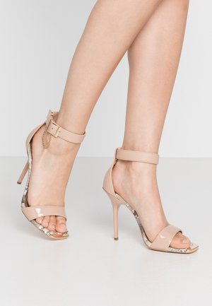 High heeled sandals - neutral