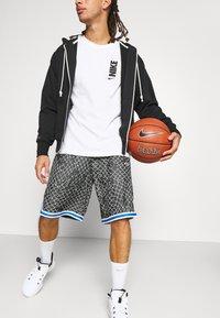 Nike Performance - SEASONAL DNA  - Sports shorts - black/light smoke grey - 3